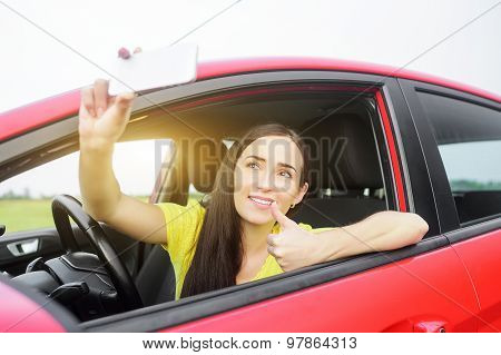 Woman taking selfie picture.