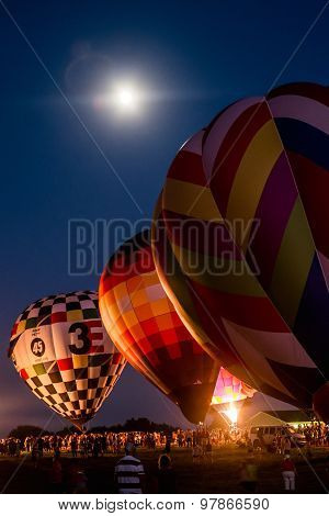 Lavish hot-air balloon display over a full moon's night
