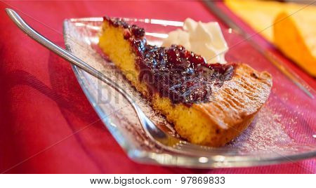 Slice Of Italian Tart Crostata With Cherries Served On Glass Plate With A Fork