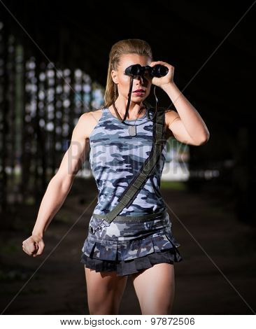 Young woman in uniform with binoculars (dark version)