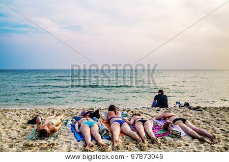 KOH CHANG, THAILAND- APRIL 15, 2015: Tourists sunbathing on sand of Lonely beach at Koh Chang island. Lonely beach - the main holiday destination backpackers at Koh Chang.