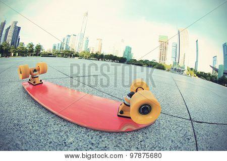 closeup of skateboard on cityshot on fish eye