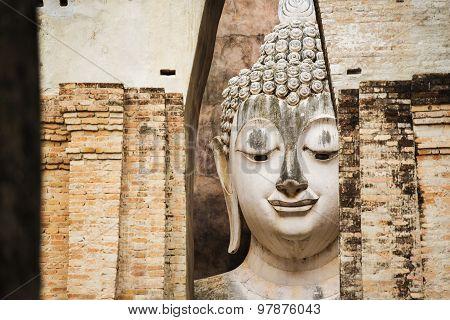 Close up Big buddha statue at Sukhothai historical park. Srichum Temple ,Thailand.