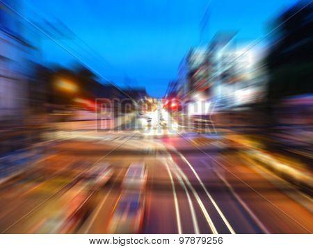 Motion blur,zoom blur of crossroad in night city,Thailand