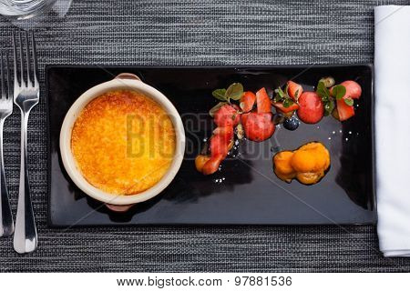 Creme brulee with strawberry foam and sea buckthorn sorbet