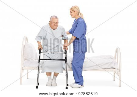 Young female nurse helping a senior patient with a walker isolated on white background