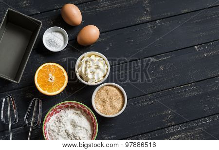 Raw Ingredients - Flour, Eggs, Butter, Sugar, Orange - To Cook Orange Cake. Ingredients For Baking.
