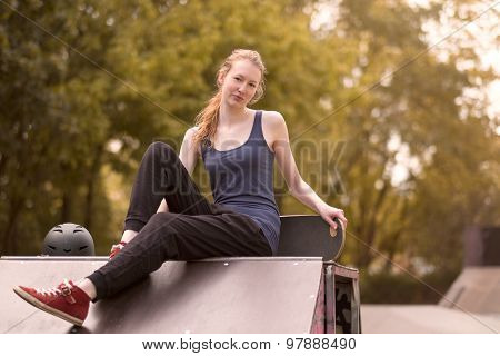 Athletic Young Woman Relaxing Outdoor