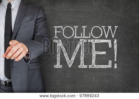 Follow me on blackboard with businessman