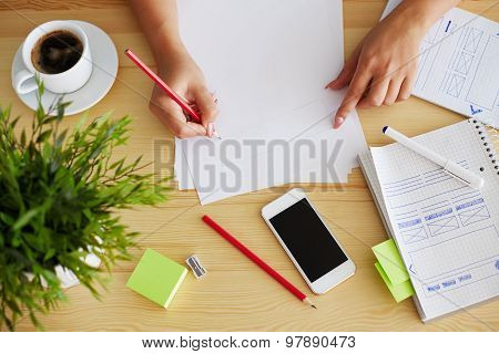 Graphic Designer Sketching Web Design