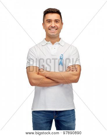medicine, health care, gesture and people concept - middle aged latin man in t-shirt with blue prostate cancer awareness ribbon pointing finger on himself