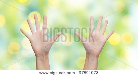 gesture, people, and body parts concept - two woman hands showing palms or making high five over blue sky and clouds background