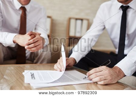 Hands of employee signing contract