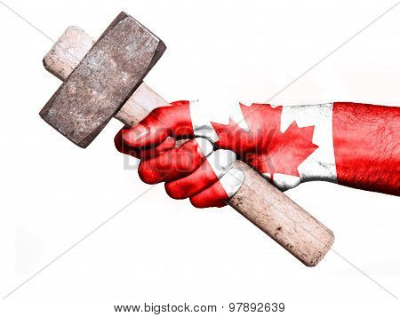 Hand With Flag Of Canada Handling A Heavy Hammer