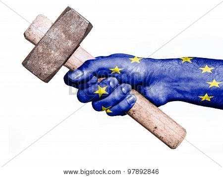 Hand With Flag Of European Union Handling A Heavy Hammer