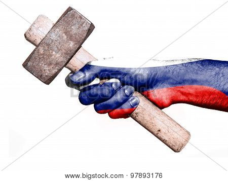 Hand With Flag Of Russia Handling A Heavy Hammer