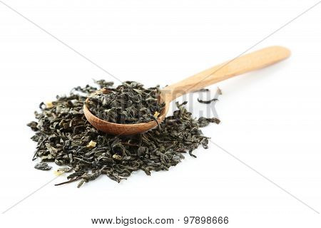 Dry Tea In Spoon Isolated On White