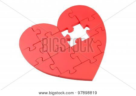 Red Puzzle Heart isolated on a white