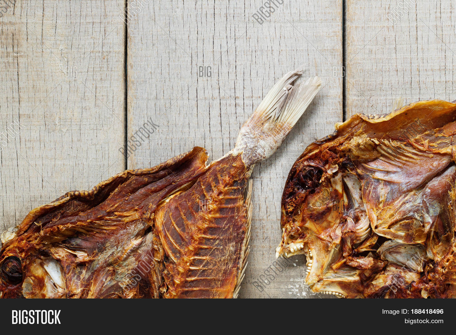 Dried salted fish on old wooden image photo bigstock for Dried salted fish
