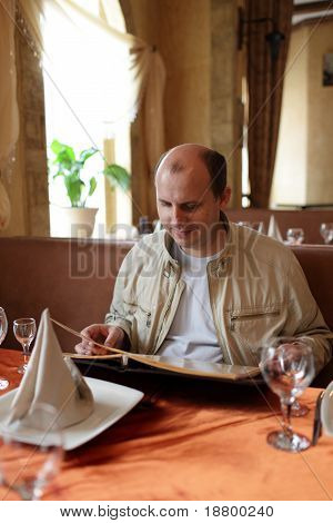 Man Reads Menu