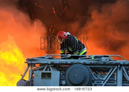 Fireman fighting huge flames