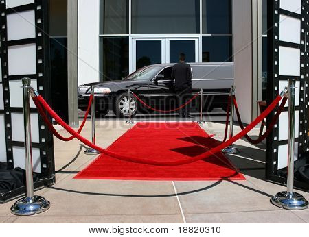 Red carpet and limousine