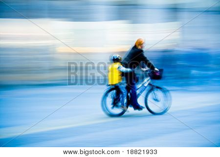 Mother and son driving on a bike