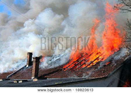 Old roof on fire