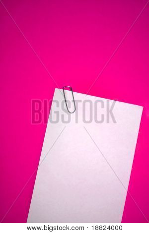 Memo paper and staple on pink backgrund