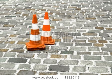 Traffic cones on an old stoney road