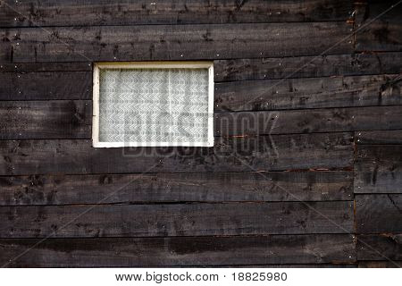 Wooden barn window