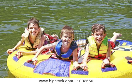 Three Boys Tubing