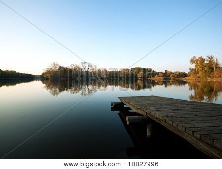 Autumn lake scene with wooden dock