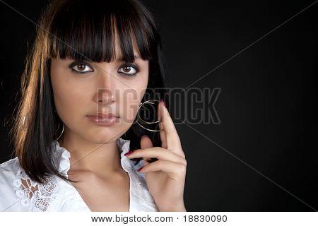 The Girl Holds  Hand An Earring