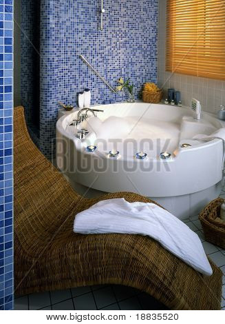 bathroom with big round bath