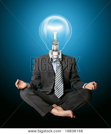 businessman in lotus pose and lamp-head meditating
