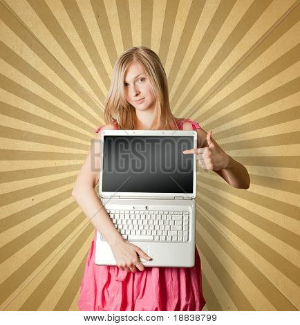 femaile woman in pink with open laptop showing something