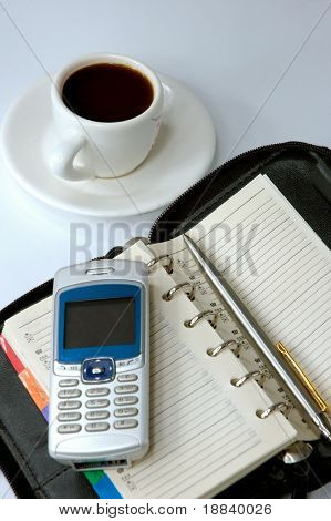 Cup of black coffee cellphone and a laptop business conceptual still-life background
