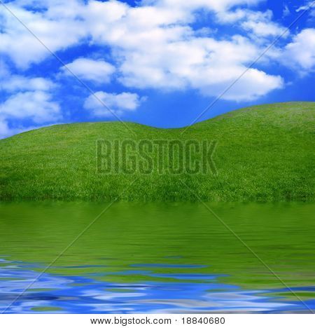 Beautiful summer landscape green grass under blue sky with reflection in water nature scenic
