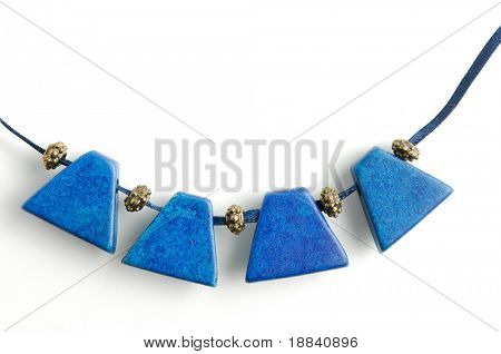 Close-up of necklace with blue gemstones Isolated on white background