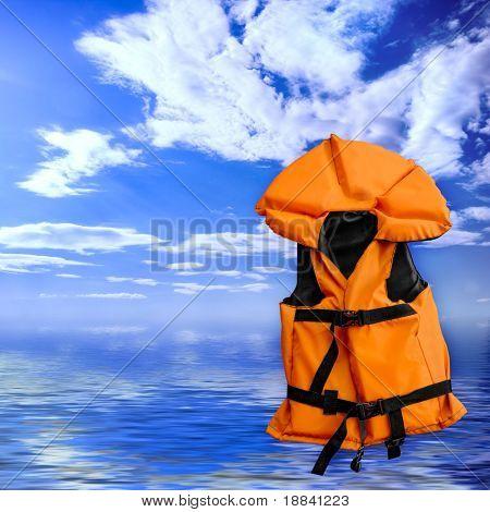 Orange life vest rescue jacket over blue summer seascape background