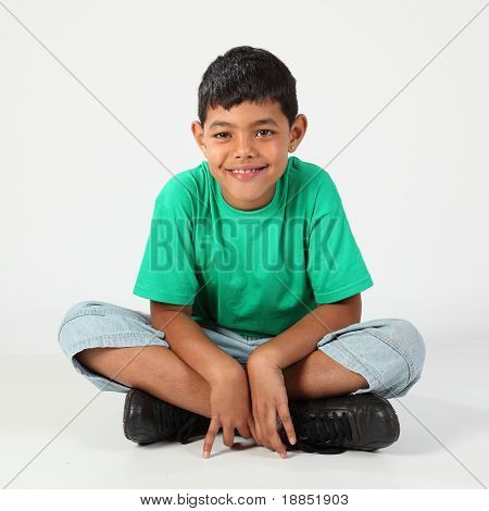 Cute school boy cross legged