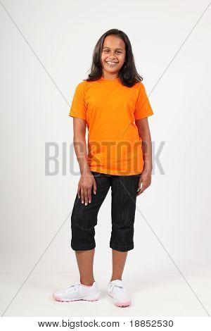 School girl standing in studio