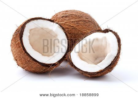 Closeup of cracked coconut on white background with light shadow