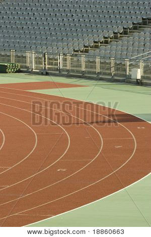 Running Tracks And Empty Seats In A Stadium