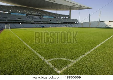 Green Grass Field And Corner Lines In An Empty Stadium