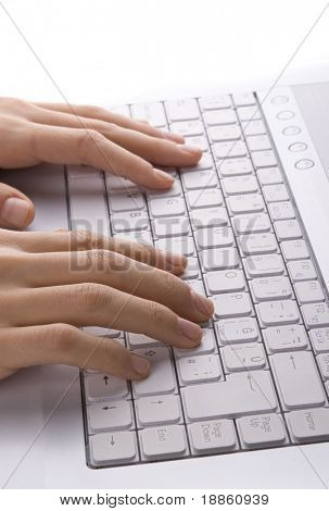 Female hand typing at the laptop keyboard