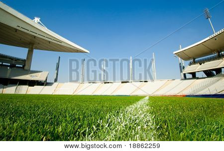 Empty Stadium Shot From Dividing Line Of The Green Grass Soccer Field