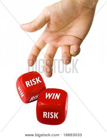 Male hand rolling red dice with win and risk text on isolated on white