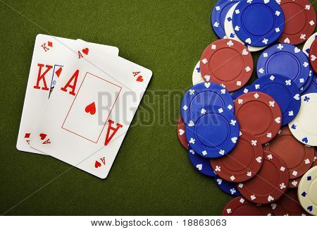 Blackjack and gambling chips on green felt
